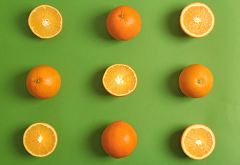 Juicy ripe oranges on color background