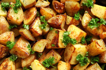 Tasty potato wedges, closeup