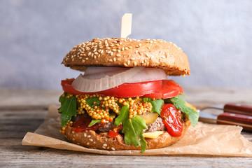 Tasty burger on table