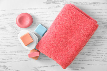 Soft towel and different soap bars on table
