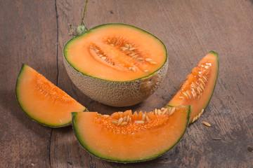 cantaloupe melon isolated on wood background