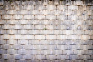 Grey textured brick wall.