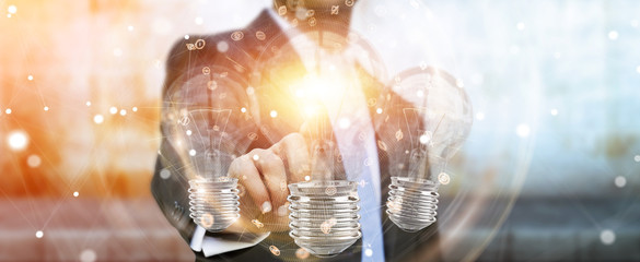 Businessman connecting modern lightbulbs with connections 3D rendering