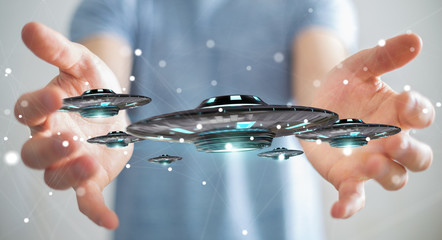 Businessman with retro UFO spaceship 3D rendering
