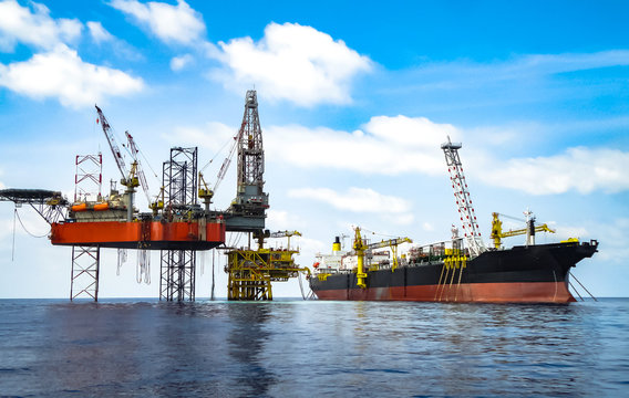 Beauty photo of drilling rig on production platform and FPSO ship.