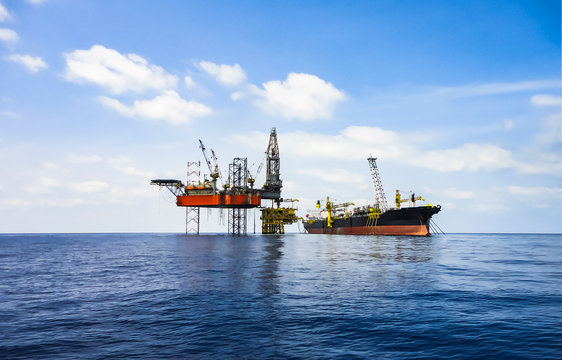 Drilling rig on production platform and FPSO ship.