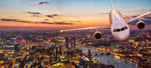 Commercial airplane jetliner flying above center of London.