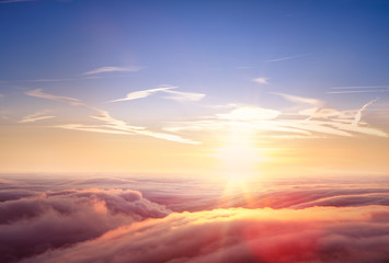 Beautiful aerial view above clouds with sunset.