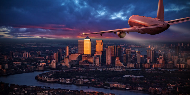 Airplane jetliner flying above business district of London.