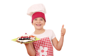 happy little girl cook with crepes on plate and thumb up