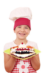 happy little girl cook with sweet crepes dessert