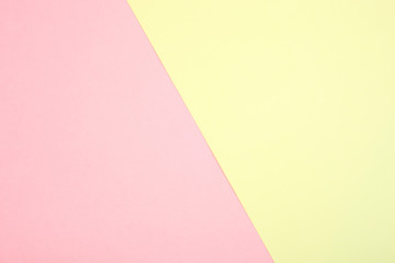 Background of pink and yellow paper in pastel colors