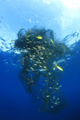 Ghost net. Abandoned fishing net pollution of ocean environment