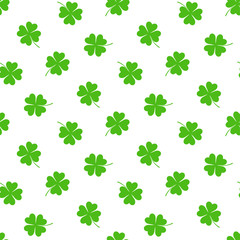 Hand drawn seamless vector pattern with four leaf clovers on a white background. Design concept for Saint Patrick's day celebration, kids textile print, wallpaper, wrapping paper.