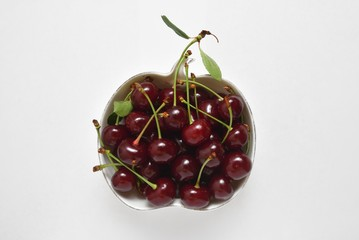 Beautiful and fresh cherry in a bowl on a white background
