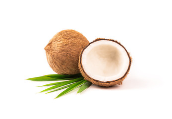 Coconut with half and leaves on white background.