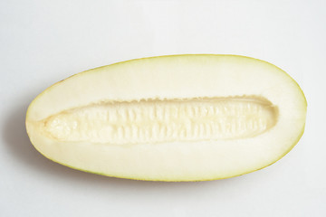 Beautiful and ripe yellow melon on a white background. Cut