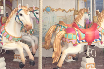 Carousel at a carnival or festival. Decorative ornate horse at a fun fair