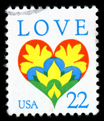 Vintage 1987 United States of America 22c cancelled postage stamp showing an image of a love heart