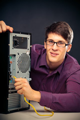 Young Man Connecting A Network Cable