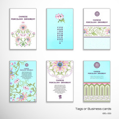Set of six  vector vertical business cards. Lotus flowers and leaves are painted by watercolor. Imitation of chinese porcelain painting. Hand drawing. Place for your text.