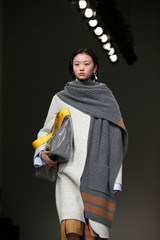 A model displays a creation during the Eudon Choi show at London Fashion Week