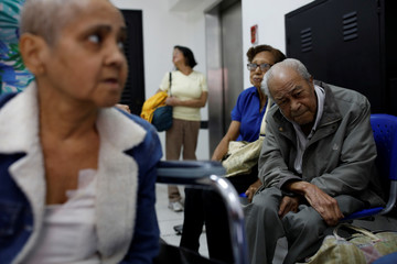 Francisco Marti, a kidney disease patient, recovers while waiting to be picked up after a dialysis session, at waiting room of a dialysis center in Caracas