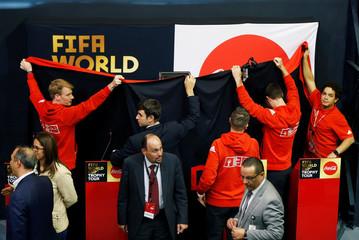 Officials prepare the FIFA world cup trophy for display during the Fifa World Cup Trophy Tour, in Amman