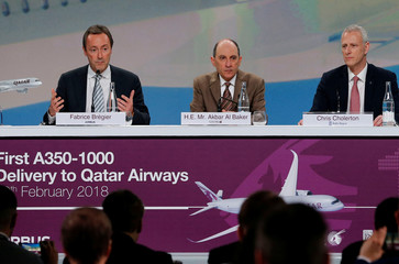 Airbus COO Fabrice Bregier, Qatar Airways Chief Executive Akbar Al Baker and Rolls-Royce President civil aerospace Chris Cholerton attend a news conference before Airbus delivers the first A350-1000 to Qatar Airways, in Blagnac