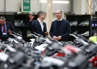 Britain's Prince William visits the Triumph Motorcycles with CEO Nick Bloor in Hinckley