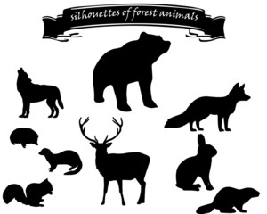set of black silhouettes of forest animals