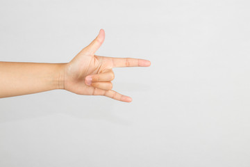 Hand showing finger gesture on white background - I love you symbol.