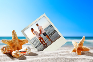 two lovers on beach and shells decoration on sand