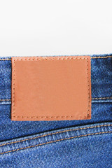 Empty Leather Tag on Denim Blue Jeans Back Side. Pair Classic Blue Jeans Close Up View Template.