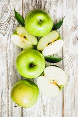 Culinary background, green apples on shabby white wooden background. Top view, copy space.