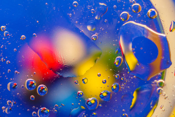 Oil on water - abstract macro background.