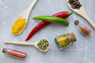 Set of spices and herbs on light stone background