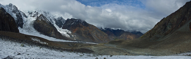 Panorama of valley with view to snow mountains