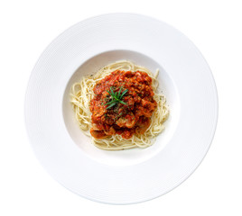 Spaghetti tomato sauce in ceramic plate top view isolated on white background, clipping path included