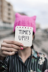 woman with a pink hat and the text time is up