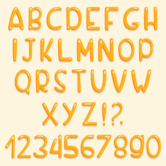 Glossy font design. Yellow ABC letters and numbers. Set of cartoon letters