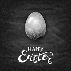 Easter egg with ornate elements on black chalkboard background