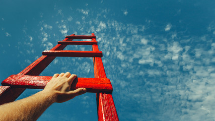 Development Attainment Motivation Career Growth Concept. Mans Hand Reaching For Red Ladder Leading...