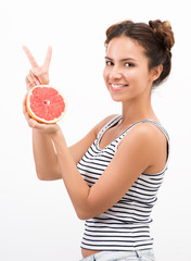 Healthy eating and freshness. Joyful young woman with citrus fruit