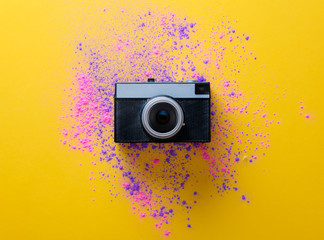 Pink and purple paint and vintage camera