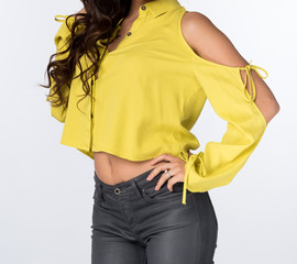 Attractive Woman in a Fashionable Yellow Crop Top and Gray Skinny Jeans - Close up
