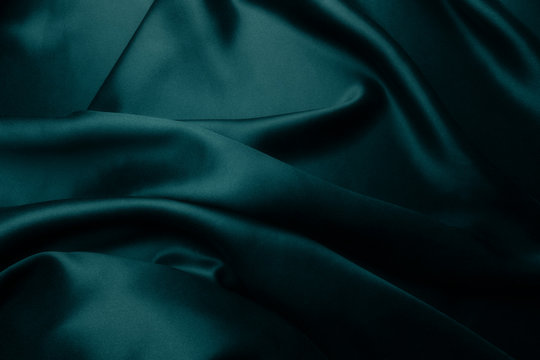Elegant blue satin silk with waves, abstract background