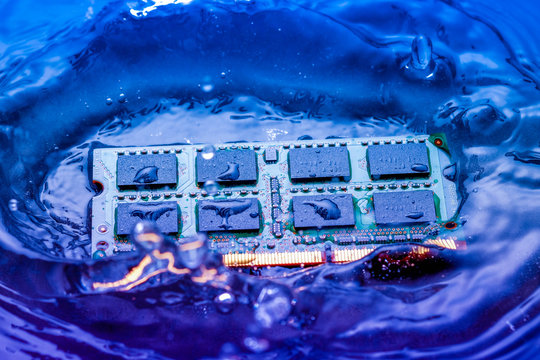 technology cyber electronic concept. cpu ram computer Fall into the water on blue light background. CPU cooling with water