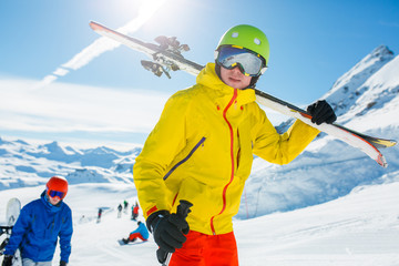 Photo of sports men with skis and snowboard in winter