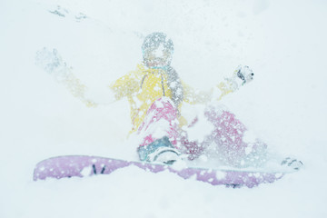 Snowy photo of woman with snowboard on winter mountain slope